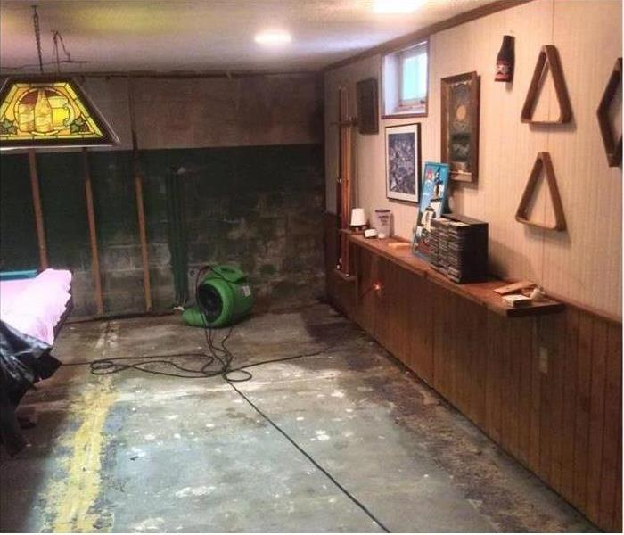 air mover and bare concrete pad in this basement man-cave