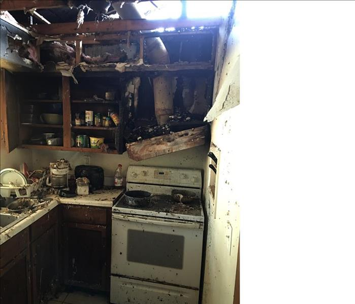 hole in the roof, exhaust hood and kitchen destroyed by fire