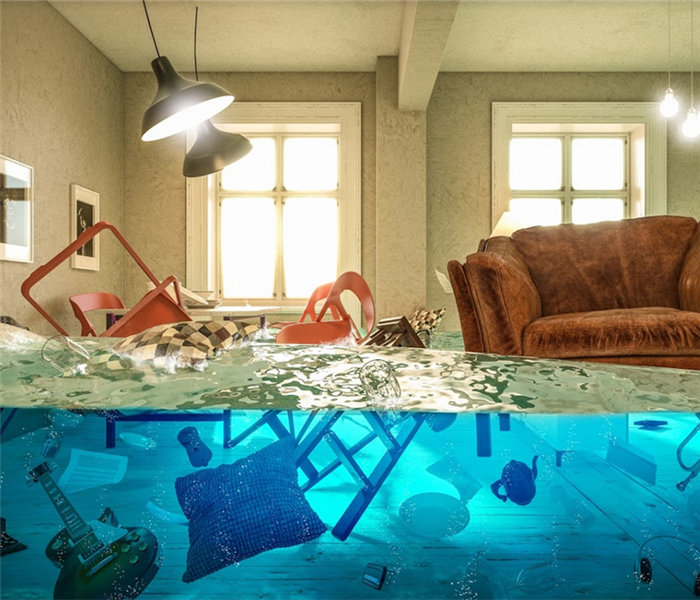 flooded living room with couch and other furniture floating